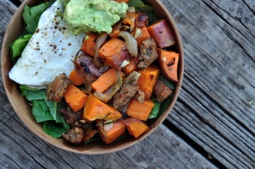 sweet potato + sausage hash over greens with a fried egg + avo crema